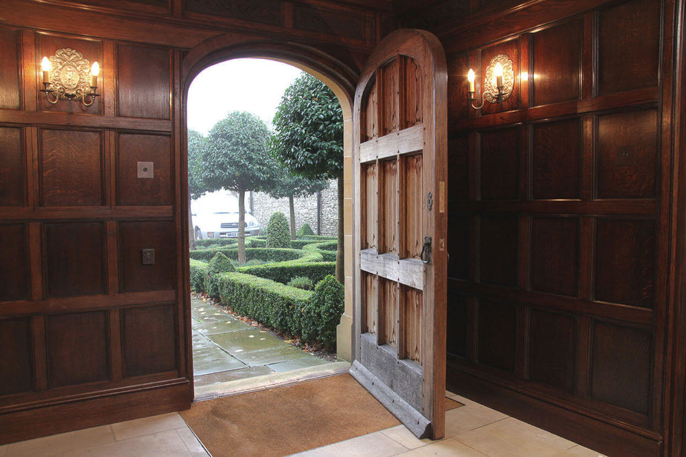 Bespoke Period Joinery Oak Panelled linenfold door and 16th Century style panelled Room