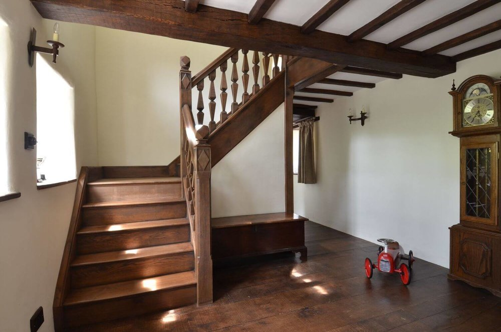 An early period 16th, 17th style century Staircase in antique oak. ABespoke designed staircase in a Jacobean style with hand made and cut finials carved newels and balusters staircase.
