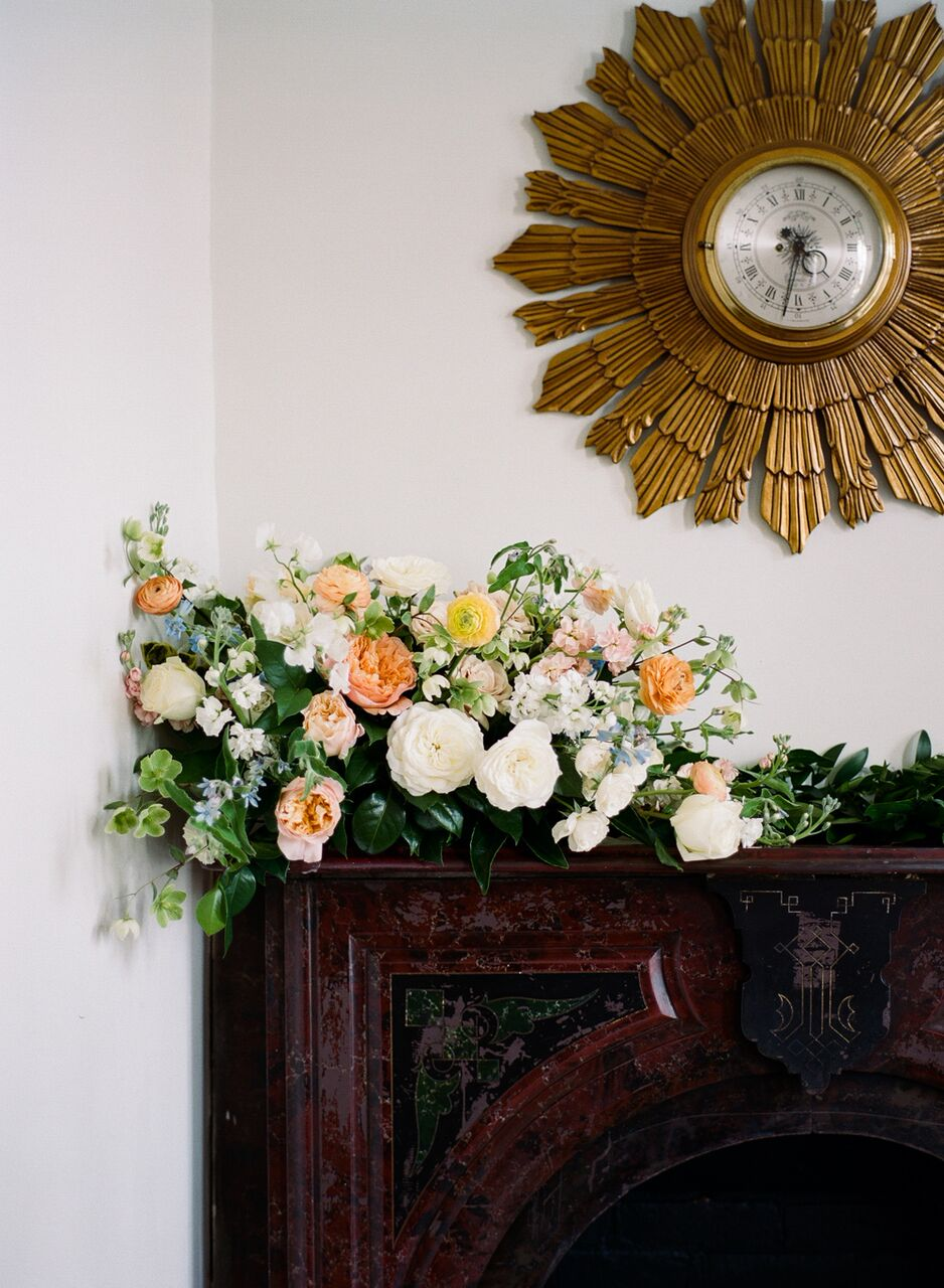 An original  Merrimon-Wynne House  mantel dressed up with floral by  Meristem Floral .