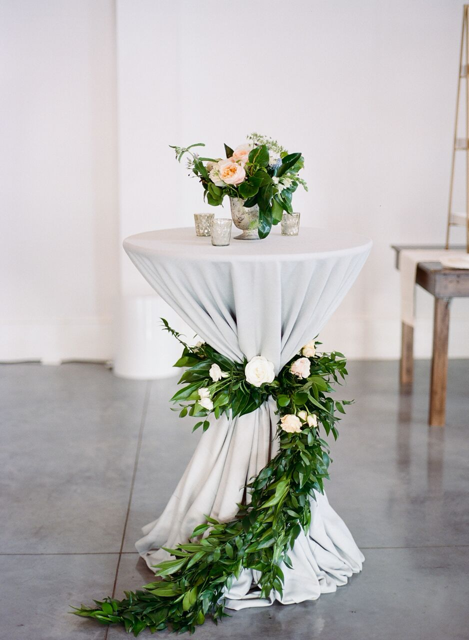 Greenery wrapped around a cocktail table is a dream!