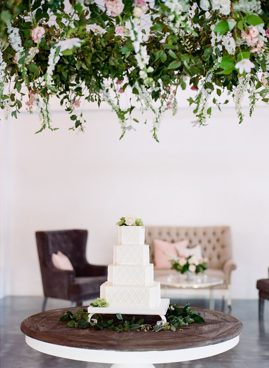Stunning work by   Meristem Floral  dangled above the wedding cake by  Cinda's Creative Cakes  .