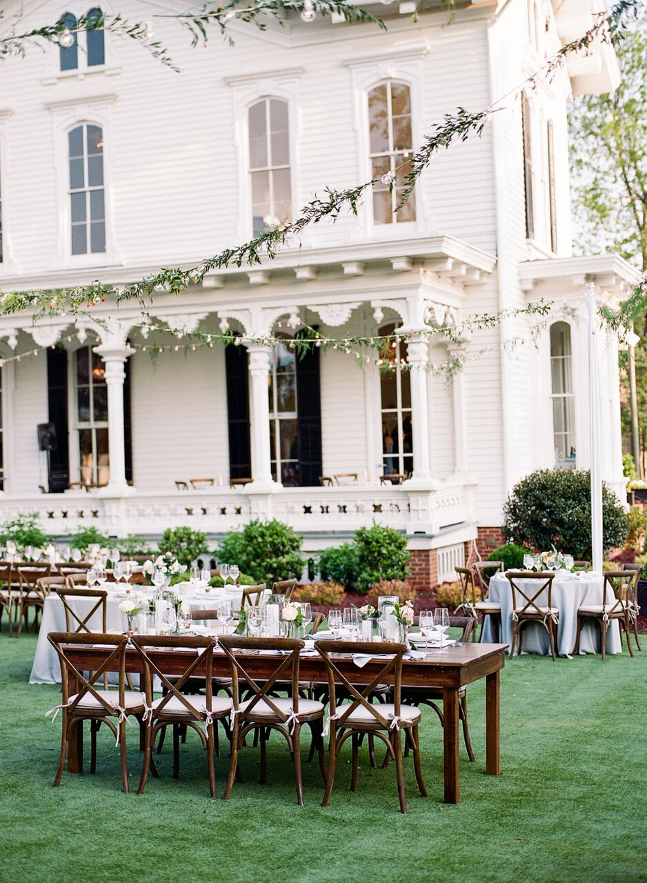 Al fresco dinner on  The Merrimon-Wynne House  Lawn!   Party Reflections  market lights with  Meristem Floral  greenery.