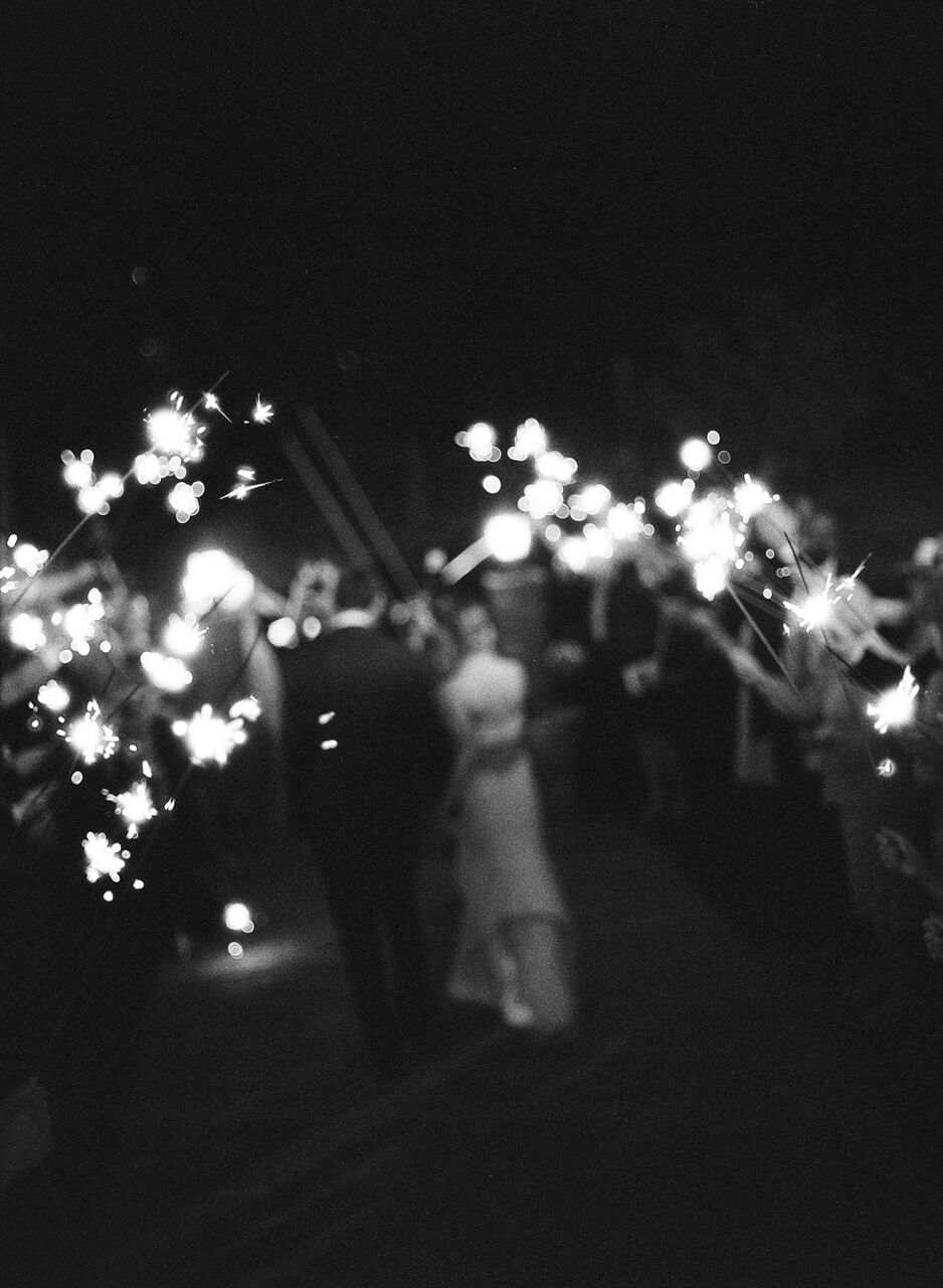 What better way to end a wedding than with a sparkler exit?!