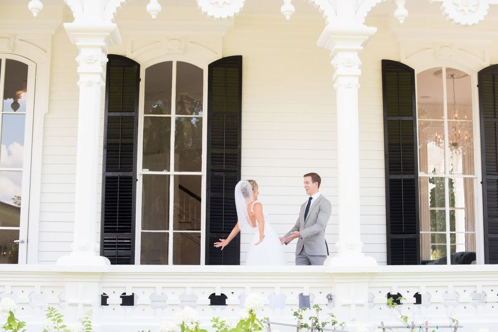 bride and groom first look on the side porch at The Merrimon Wynne House