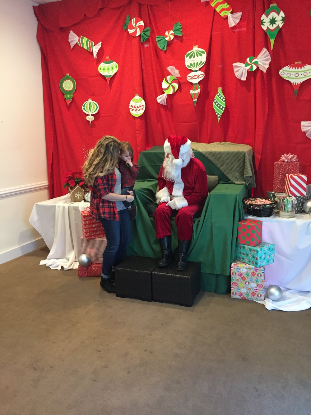 Telling Santa his Christmas wishes!
