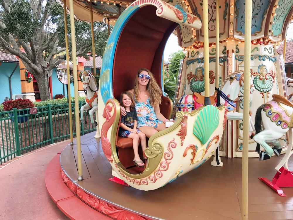 Riding the carousel at Disney Springs