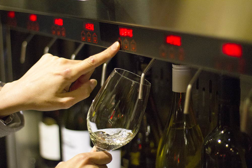 3. Press the button to serve your wine