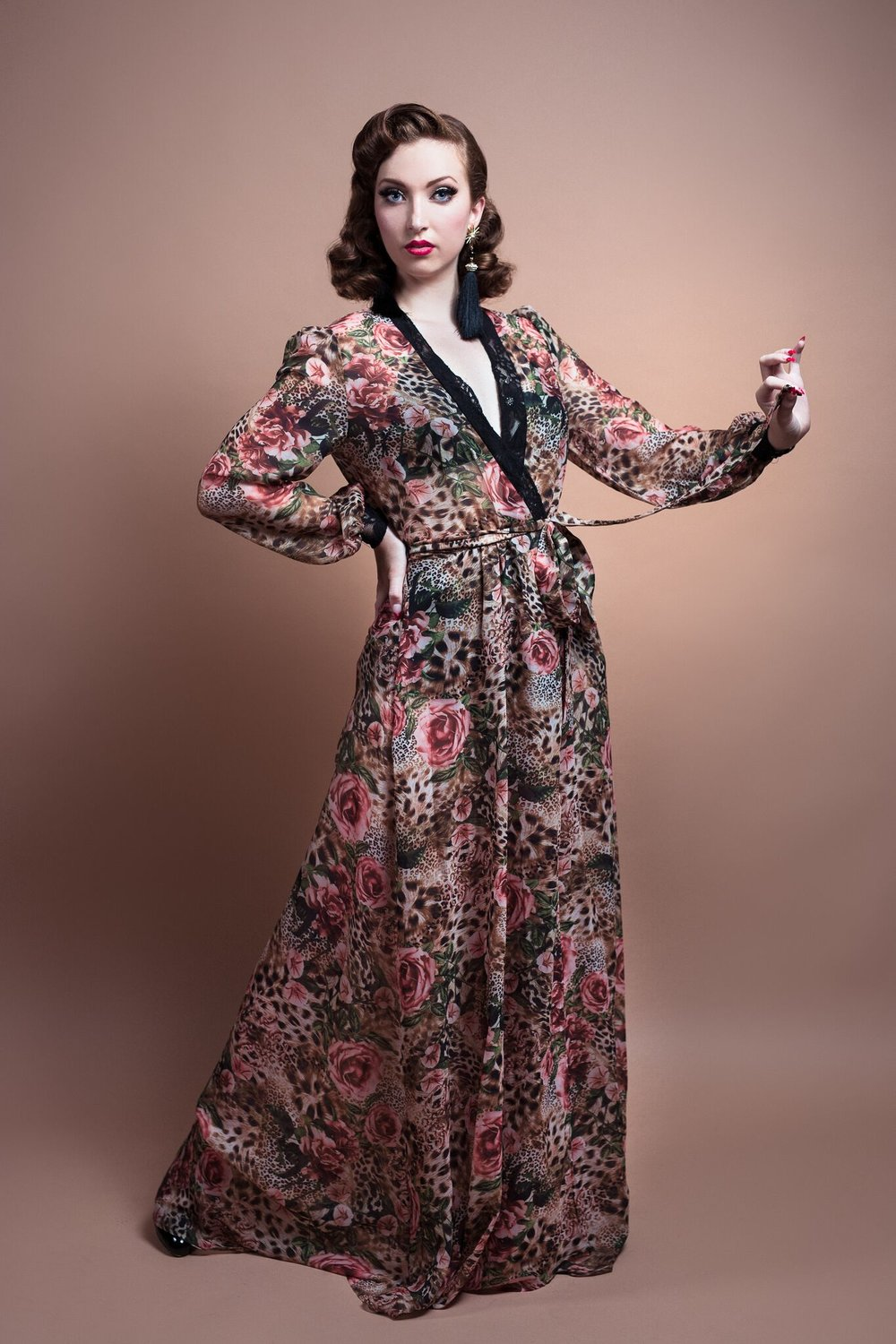 Sheer Glamour Dressing GownLeopard Print -$179 - This 1940's inspired sheer peignoir is a special feature to this Boudoir Collection. Made out of a unique leopard and rose print polyester chiffon…this piece is both fierce and feminine.The peignoir drapes beautifully around the body and is excellent for glamour shoots, backstage elegance or just simply wanting to bring a bit of drama into your home.The cuffs and the front bodice are highlighted with a touch of black lace.Citrine is wearing a Size 10 in the Sheer Glamour Dressing Gown