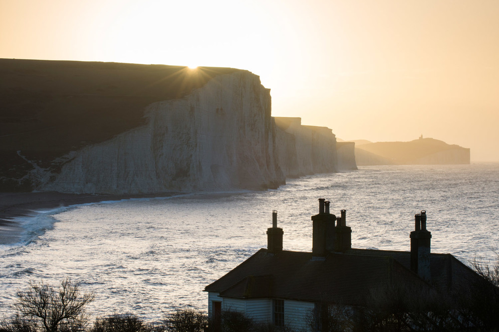 Coastguard Cottages and Seven Sisters at sunrise, Sussex, England
