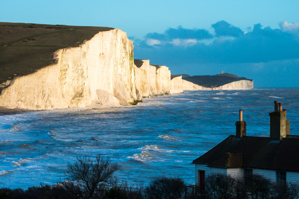 Coastguard Cottage and Seven Sisters at last light, Sussex, England