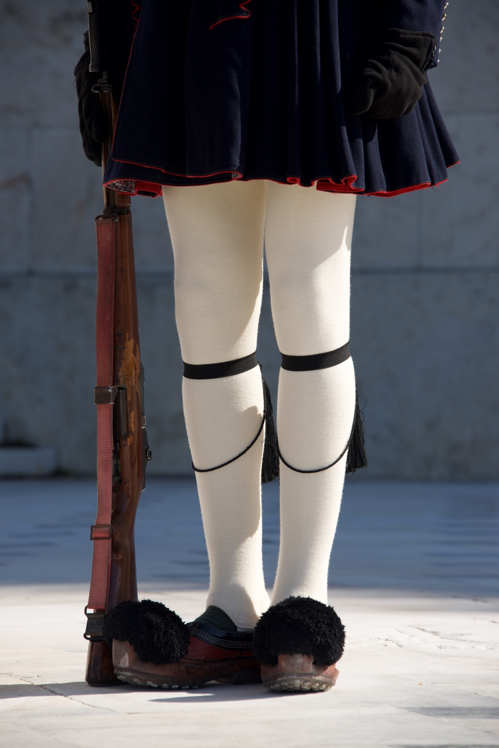 Greek guardsman with rifle from waist down.jpg