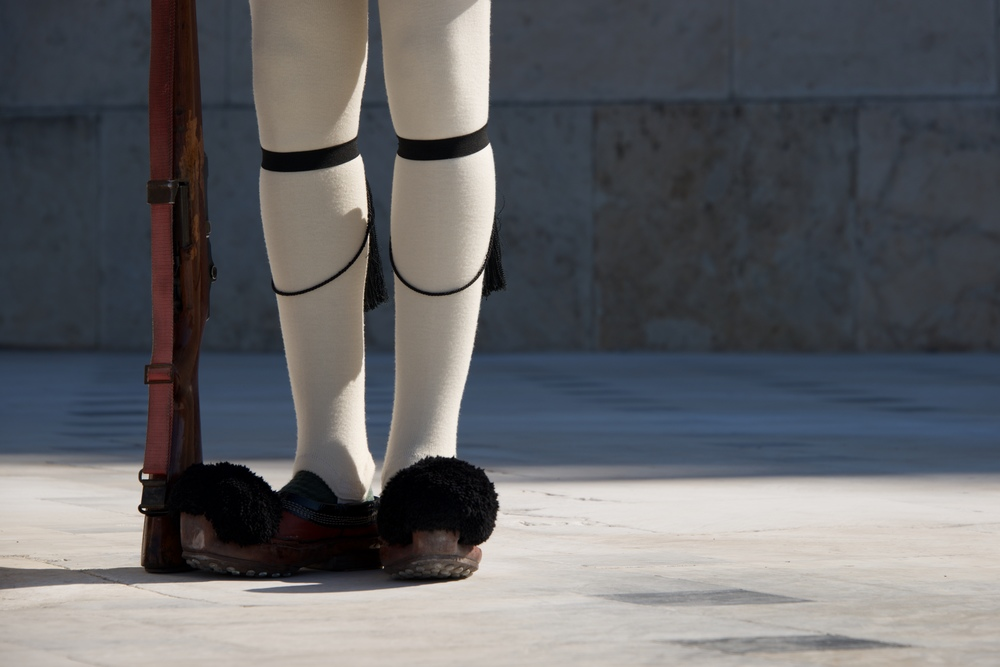 Legs and rifle of Greek presidential guardsman.jpg