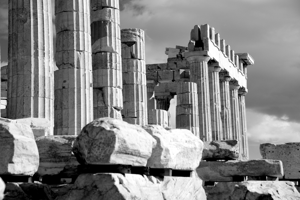 Mono piles of stones before ruined Parthenon.jpg