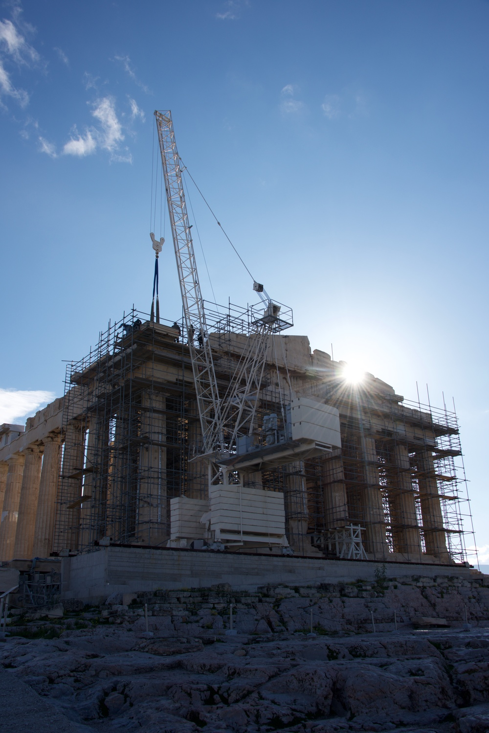 Sun rising behind Parthenon crane and scaffolding.jpg
