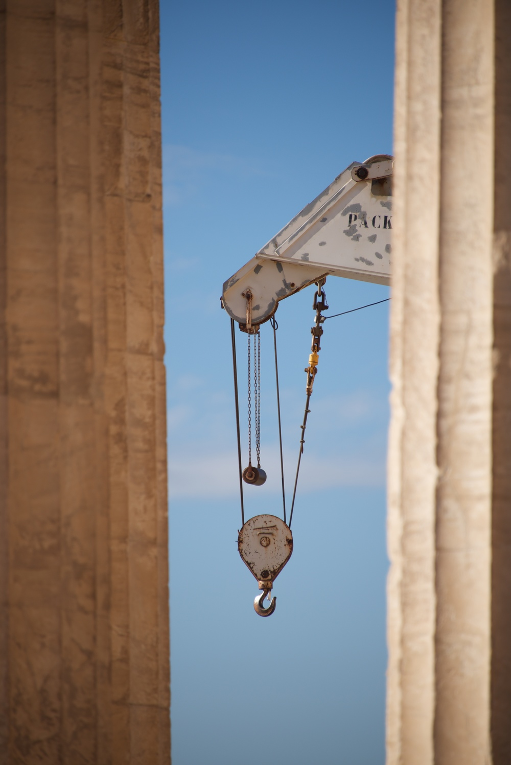 Crane appearing between two marble Parthenon columns.jpg