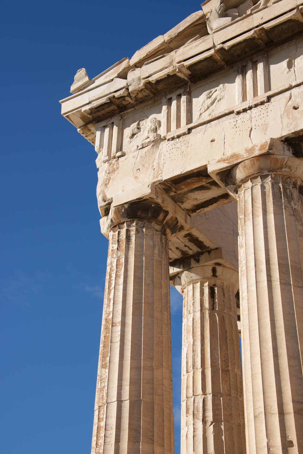 Corner of marble Parthenon colonnade and pediment.jpg