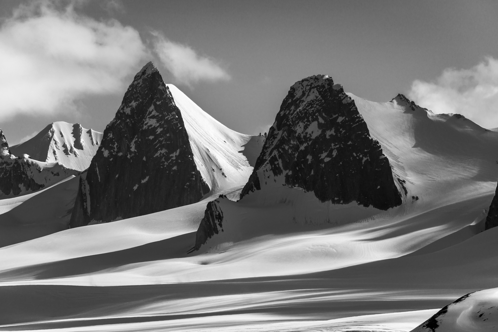 Black and white cliffs on snowy glacier