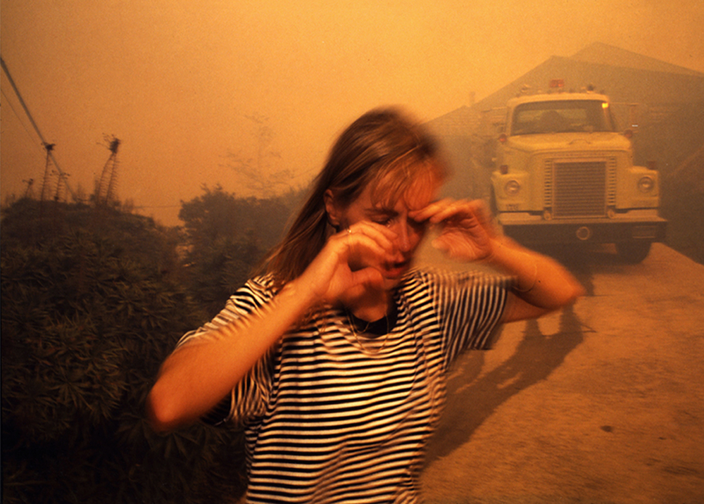 Girl Running From Malibu Fire.jpg
