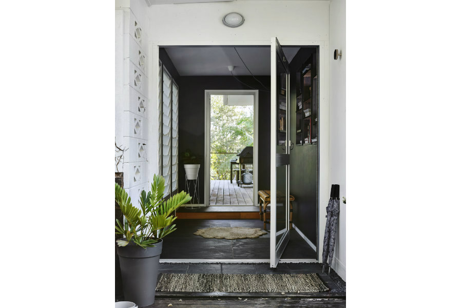 pivoting front door to entrance and side deck