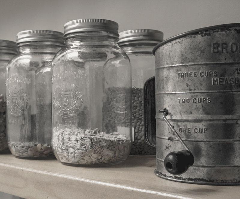 organizing baking supplies on open shelving