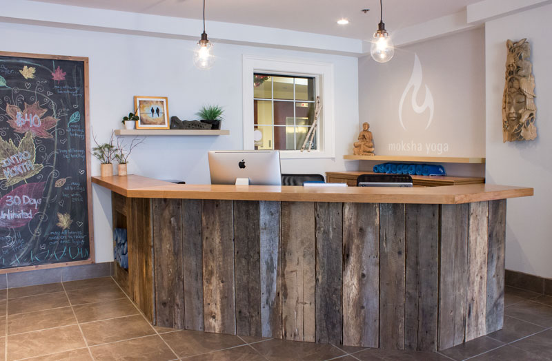 yoga studio reception desk barn boards