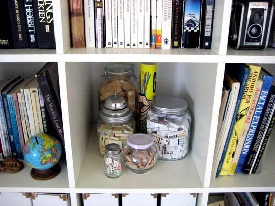 store game pieces in glass jars
