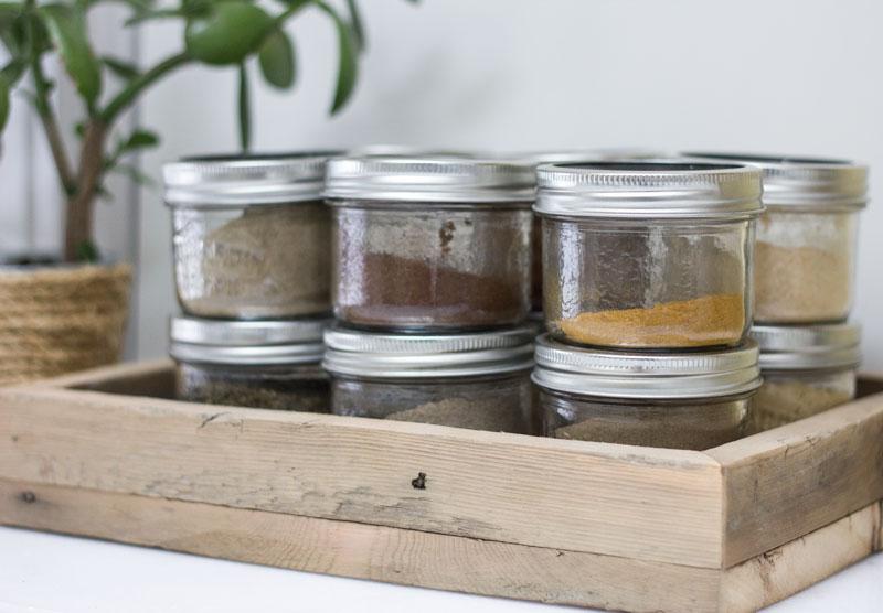 simple spice jar organization in rustic wood tray