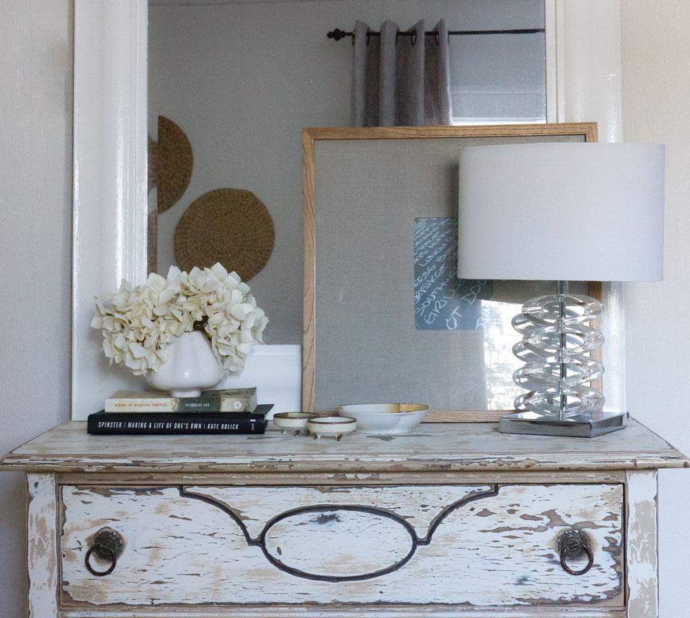 distressed dresser in rustic guest bedroom