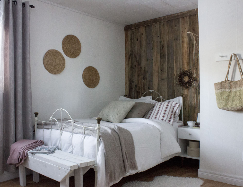 rustic guest bedroom with barn board feature wall