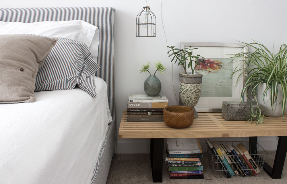 A mid-modern bench as a bedside table with a DIY hanging cage bulb lamp - click for DIY