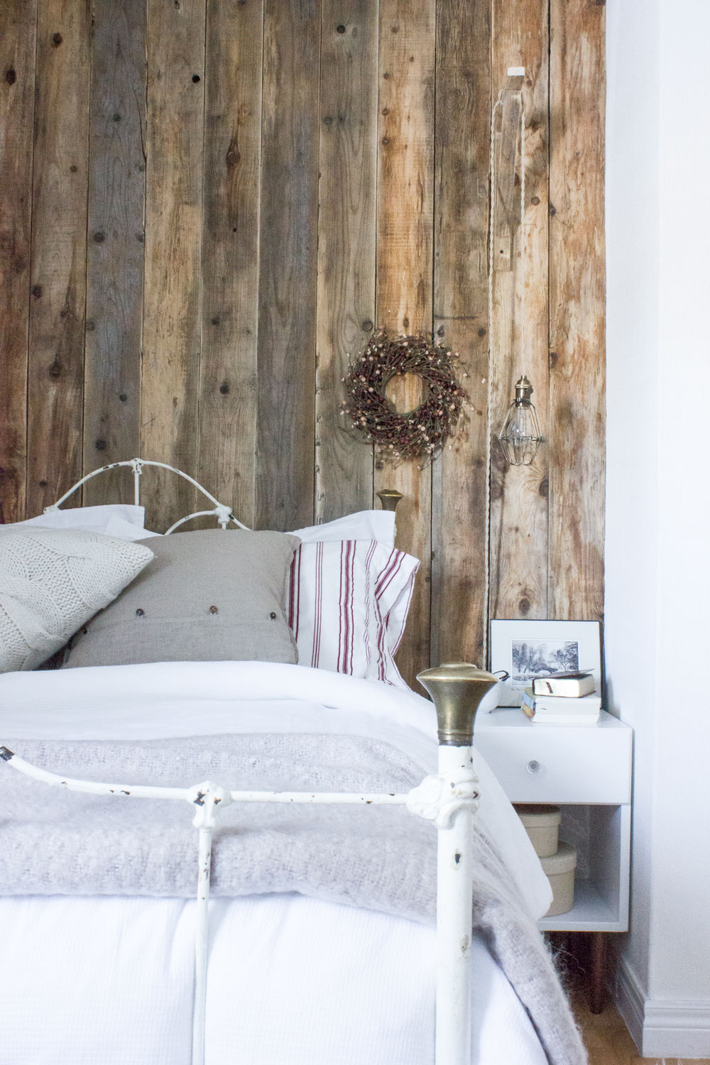 Refreshed Designs - reclaimed barnwood walls in the guest bedroom