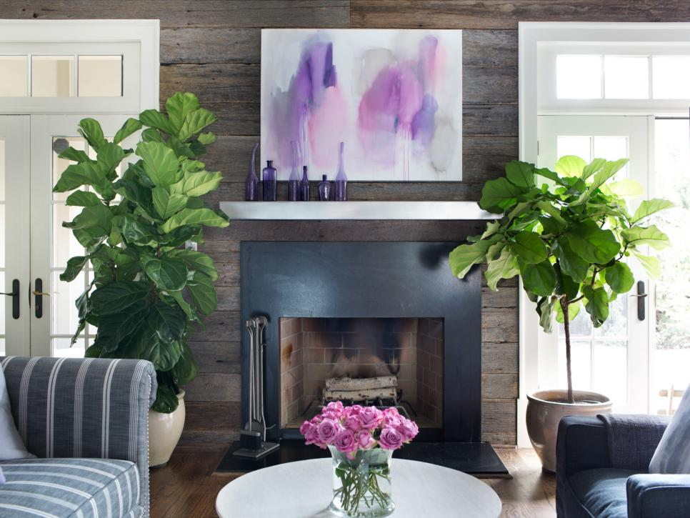 reclaimed barn wood feature wall around fireplace