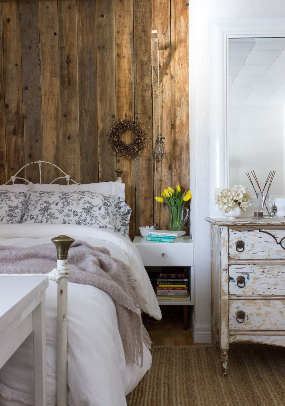 perfectly imperfect guest bedroom with barn board wall