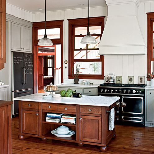 dark wood trim in kitchen with white walls and gray cabinets