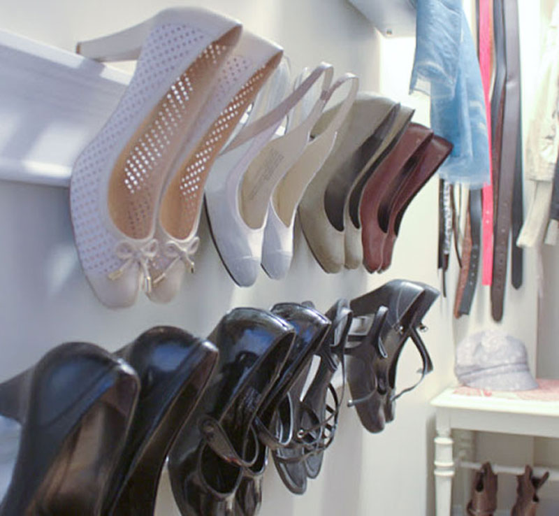 shoe storage in decluttered walk in closet