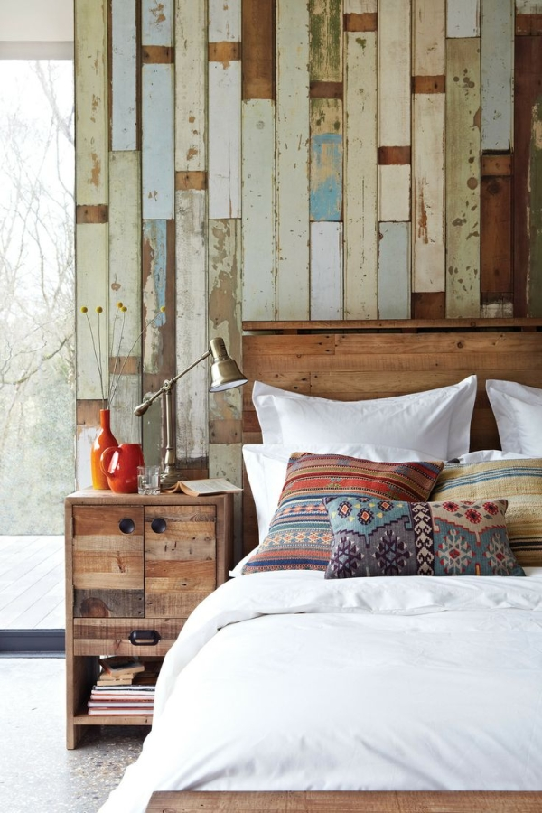 verticle salvage wood wall behind bed