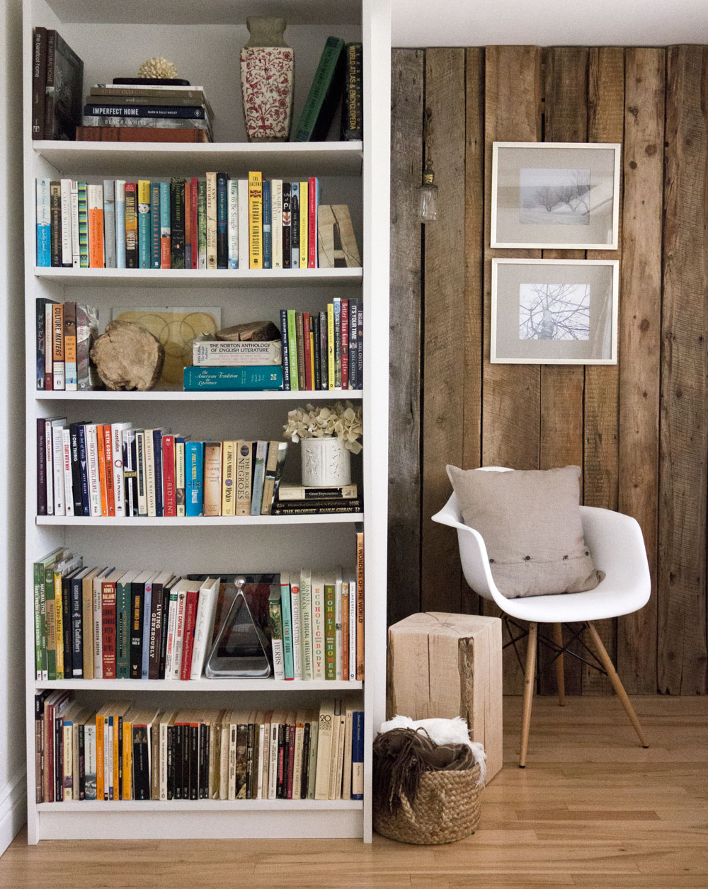 The allure of imperfection in our homes - barn board wall in living room