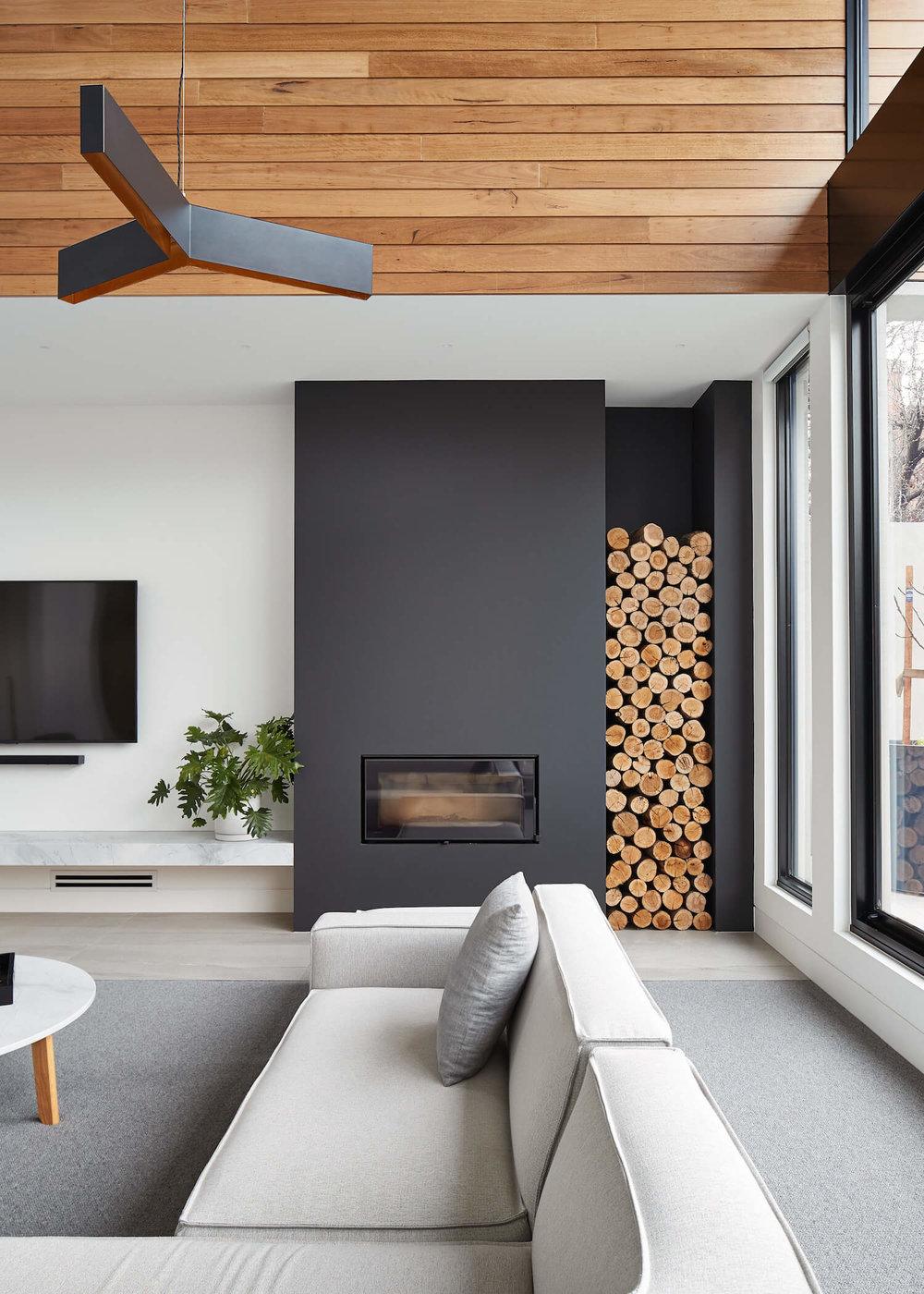 Dark focal fireplace wall via Est