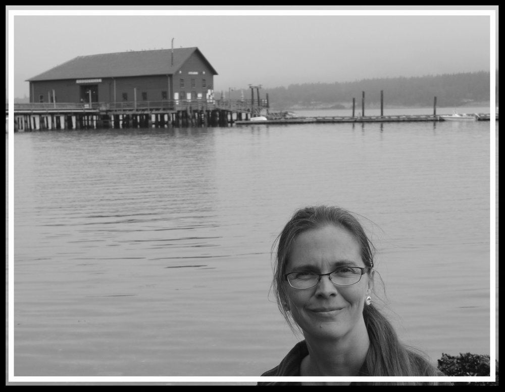 Rachel at Penn Cove, Washington. It was here that many members of the Southern Resident Killer Whale community were captured and killed in the 1960s and 70s. To this day they have not returned to Penn Cove, and are officially listed as endangered. One of the  kidnapped whales has spent the 47 years since her capture in a small tank at the Miami Seaquarium as Lolita (also known by her Salish name, Tokitae). Her mother, Ocean Sun, is alive and swims wild with the rest of their family pod. Both Toki &  Ocean Sun—along with another illuminated soul known as Tilikum—inspired central characters in  The Blackfish Prophecy .