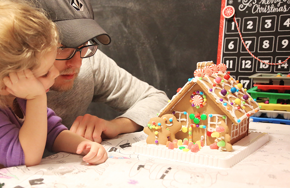 building a gingerbread house is fun for families!