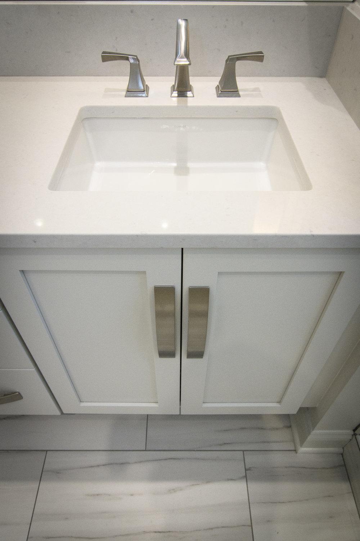 White cabinets, quartz countertops, square undermount sinks,  large format tile, Vestavia Hills, Liberty Park, Alabama, Remodel, Renovation.