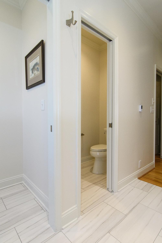 Water closet, barn door, toilet, whisper recessed light fan, large format tile, Vestavia Hills, Liberty Park, Alabama, Remodel, Renovation.