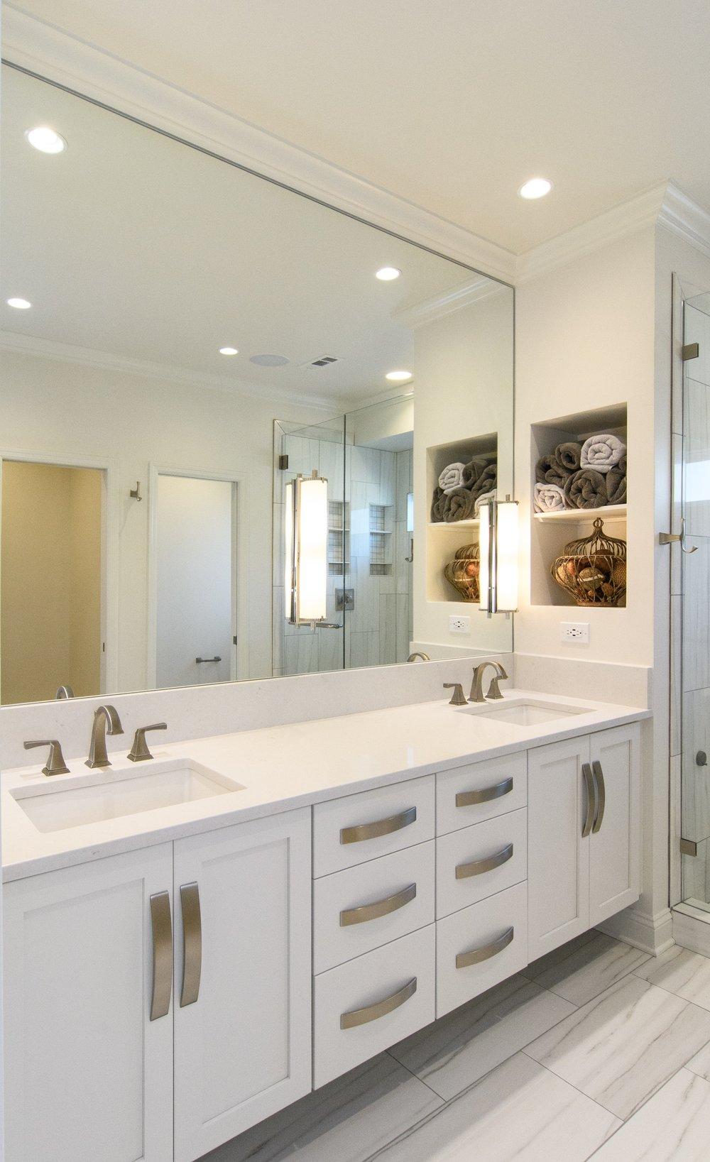 White painted cabinets, quartz countertops, rectangular undermount sinks, mirror lights, niche, large format tile, Vestavia Hills, Liberty Park, Alabama, Remodel, Renovation.