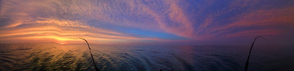 A shaky panorama of a dramatic sunrise over Lake Michigan