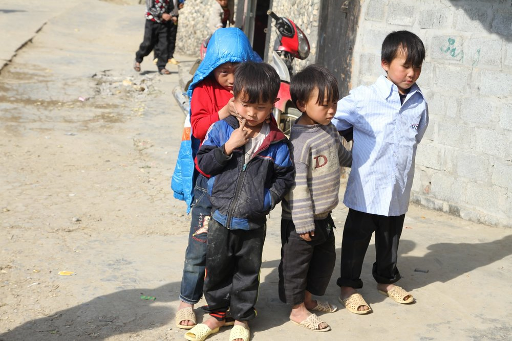 Kids in matching shoes hang out in SaPa