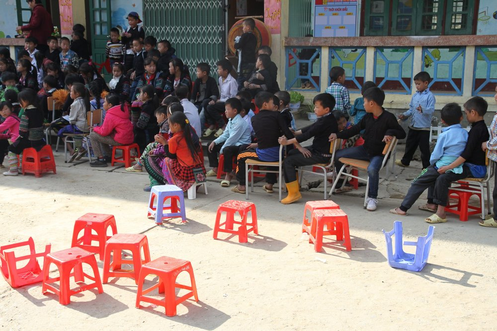 Kids watch a talent show in the school playground, Sa Pa