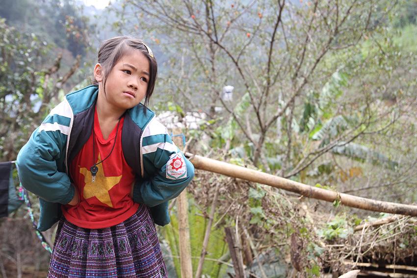 A girl wears a Communist T-shirt