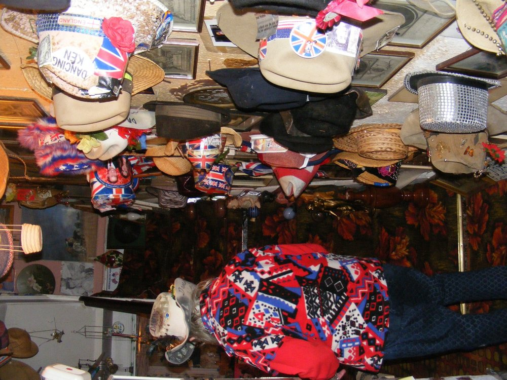"""Ken's passion for a sort of 'labour of love' and hand-made skills can be seen in his vast collection of cowboy hats, customised by Dancing Ken himself. The hats decorate the entire wall in his hallway and he tells us he has """"hundreds"""" more up in his loft."""