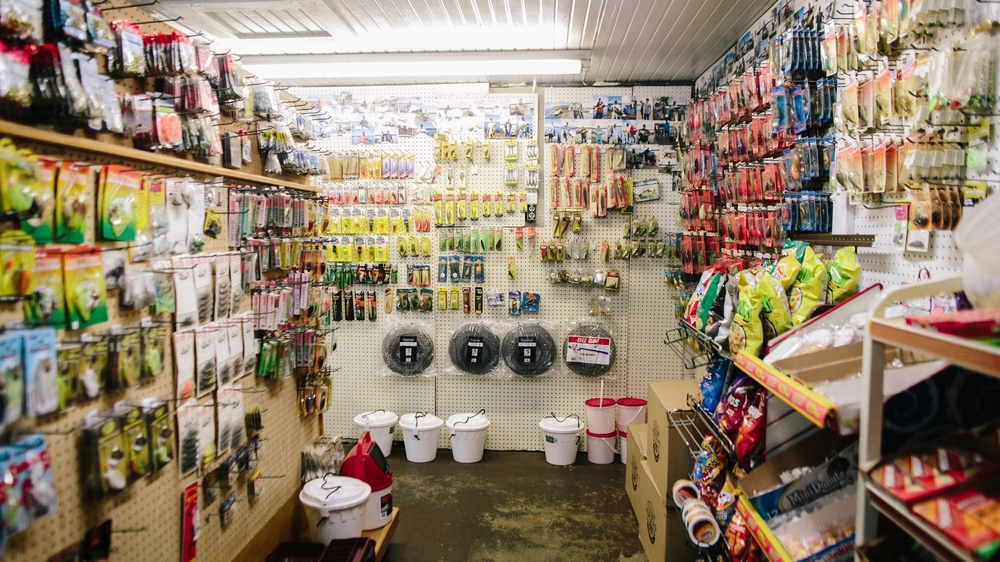A classic scene in a small-town bait shop: Minnow buckets and other fishing supplies share space with other necessities, such as on-the-water snacks.