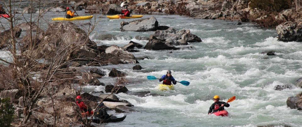 Kayakers learn how to control their crafts before taking on more challenging whitewater.